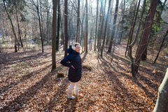 Woman standing in the forest Stock Images