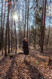 Woman standing in the forest Stock Image
