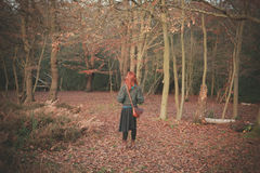 Woman standing in the forest Royalty Free Stock Photography