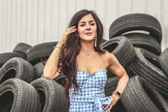 Woman Standing in Front of Car Tires royalty free stock image