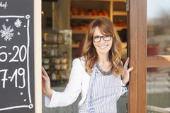 Woman standing in front of coffee shop Royalty Free Stock Image