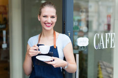 Woman standing in front of coffee shop Stock Image