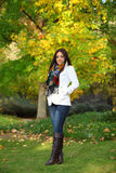 Woman standing in front of a colorful tree Autumn Stock Photos