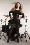 Woman standing in front of drumkit Royalty Free Stock Photos