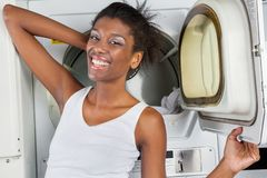 Woman Standing In Front Of Dryer Stock Photos
