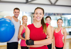 Woman standing in front of the group in gym Stock Photo