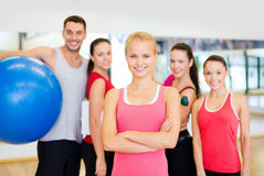 Woman standing in front of the group in gym Royalty Free Stock Image