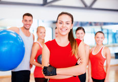 Woman standing in front of the group in gym Royalty Free Stock Photography