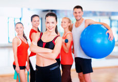 Woman standing in front of the group in gym Stock Image