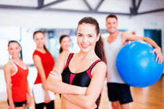 Woman standing in front of the group in gym Stock Images