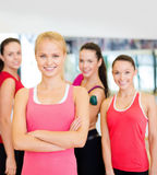 Woman standing in front of the group in gym Stock Photography