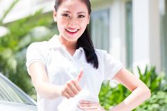 Woman standing in front of new car Stock Photography