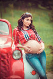 Woman standing in front of retro red car Royalty Free Stock Image
