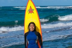Woman Standing in Front of a Surfboard stock photo