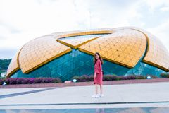 Woman Standing in Front of Yellow and Blue Glass Building Royalty Free Stock Photo