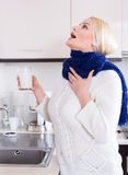 Woman standing with gargle solution Stock Photos