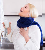 Woman standing with gargle solution Stock Image