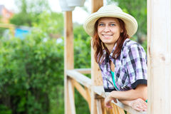 Woman standing in the gazebo in his garden Stock Image