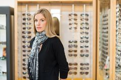 Woman Standing In Glasses Store Royalty Free Stock Photography
