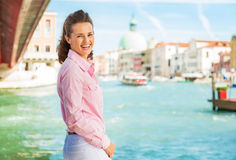 Woman standing on grand canal embankment in venice Stock Photo