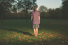 Woman standing on grass in evening Stock Photography