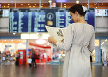 Woman standing in hall of airport Stock Images
