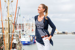 Woman standing at Harbor pier Stock Photography