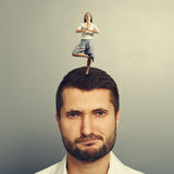 Woman standing on the head of displeased man Stock Images
