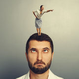 Woman standing on the head and pointing Royalty Free Stock Image