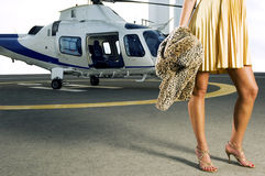 A woman standing by a helicopter Royalty Free Stock Photography