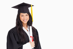 A woman standing with her degree Royalty Free Stock Photos