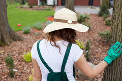 Woman standing in her garden Royalty Free Stock Images