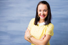 Woman standing with her hands crossed and smiling Stock Photos