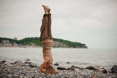 Woman standing on her head doing yoga Royalty Free Stock Image