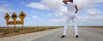 Woman Standing on Highway Royalty Free Stock Photos