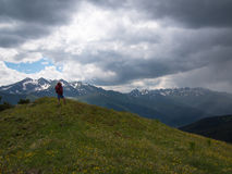 A woman is standing on a hill and looking up Royalty Free Stock Photos