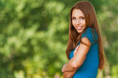 Woman standing with his arms folded Stock Image
