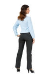 Woman standing with his back on a white background Stock Image