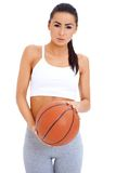 Woman standing and holding basketball Stock Photos