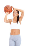 Woman standing and holding basketball Stock Photo