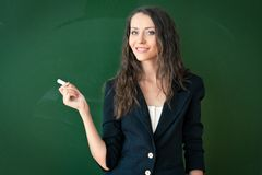 Woman standing and holding chalk Royalty Free Stock Image