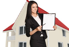 Woman standing and holding clipboard pointing pen Stock Photo