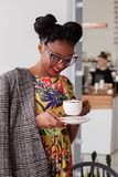 Woman Standing Holding Coffee Mug Royalty Free Stock Image