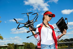 Woman is standing and holding drone Royalty Free Stock Photography