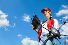 Woman is standing and holding drone Stock Images