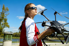 Woman is standing and holding drone Stock Photography