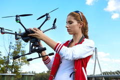 Woman is standing and holding drone Royalty Free Stock Photos