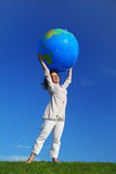 Woman standing and holding inflatable globe Royalty Free Stock Photo