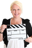 Woman standing holding a movie slate Stock Photography
