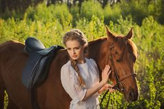 Woman walking with horse in the forest stock image